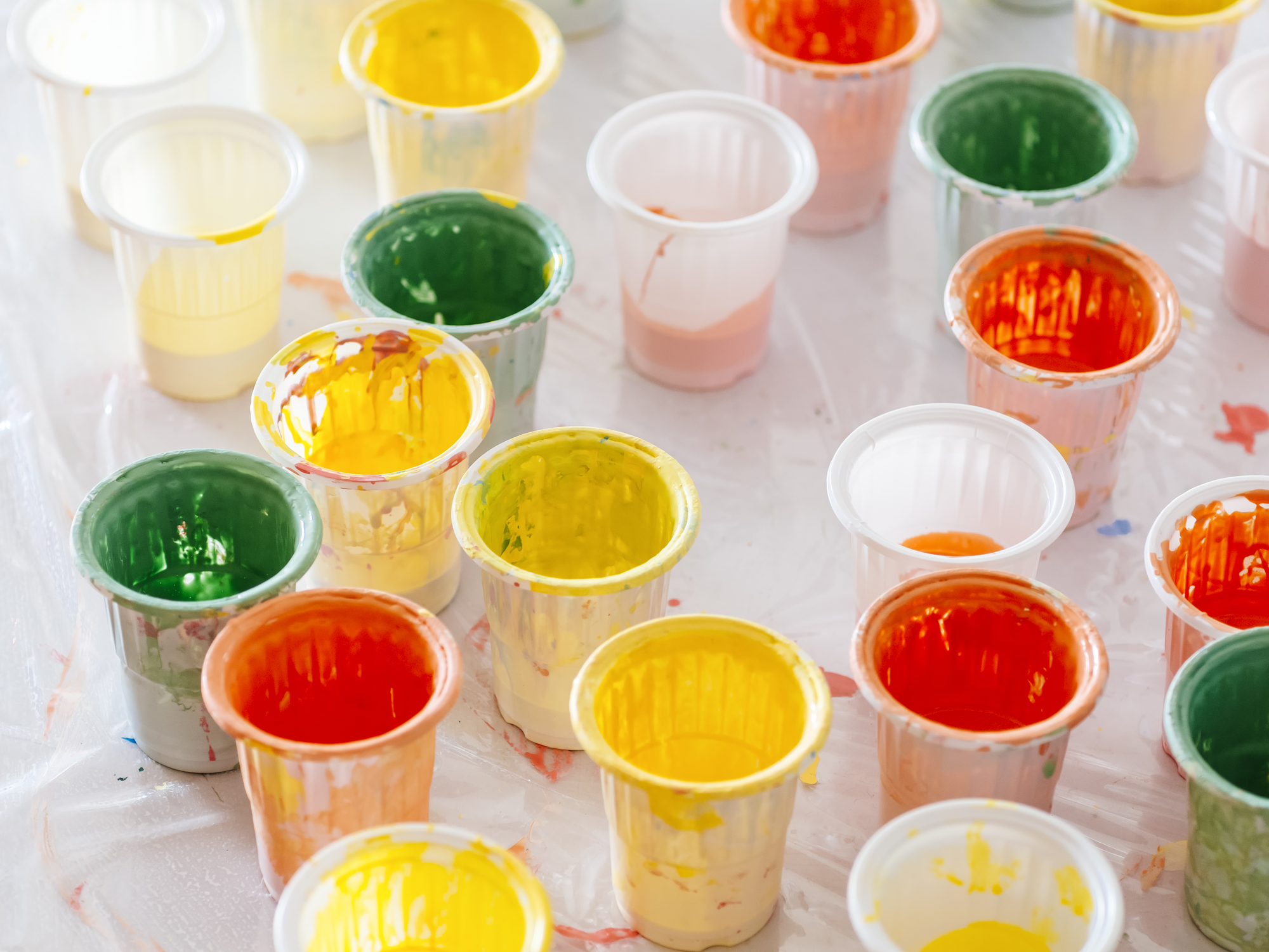 Colourful Plastic Cup on Table Painting colours pallete