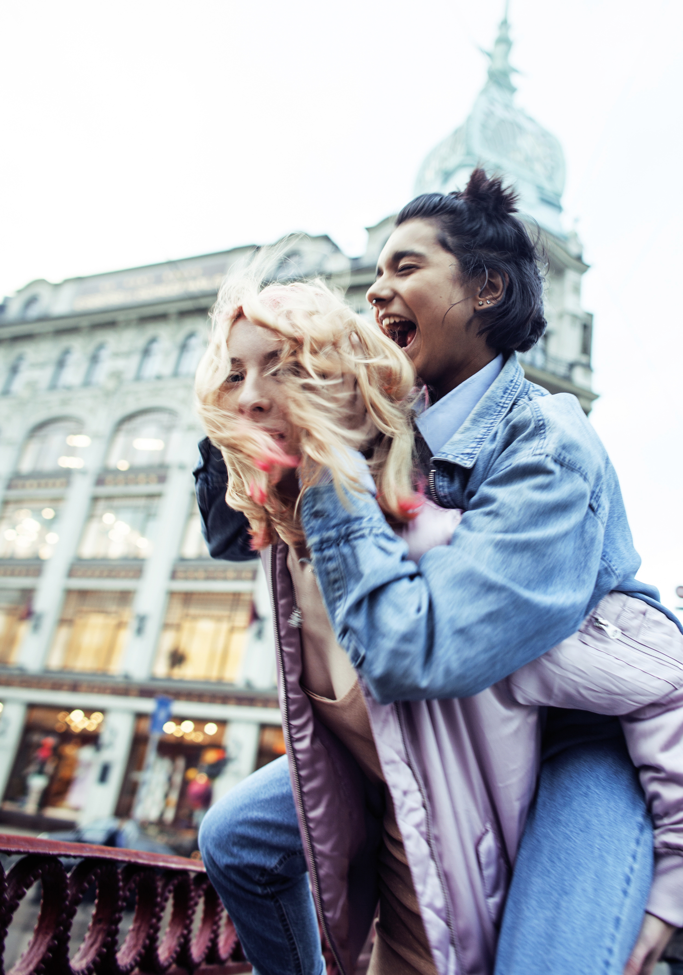 cute young couple of teenagers girlfriends having fun, traveling
